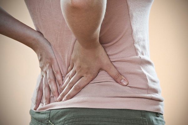 back-pain-woman-holding-back
